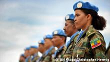 A female member of the Ethiopian battalion of the United Nations Mission in Liberia (UNMIL) joins the military observers in a parade to receive the medals in recognition of their contribution to the mission. 30/Aug/2008. UN Photo/Christopher Herwig. www.unmultimedia.org/photo/