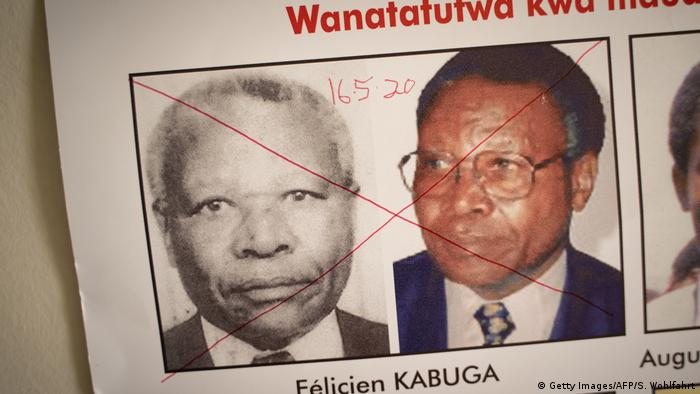 The date of arrest and a red cross are seen written on the face of Felicien Kabuga