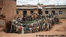 TOPSHOT - A picture taken on April 9, 2019, shows victims' clothes recovered from pits used as mass graves during the 1994 Rwandan genocide and hidden under houses in Kabuga, on the outskirts of Kigali, Rwanda. - Rwanda on April 7, 2019 began 100 days of mourning for more than 800,000 people slaughtered in a genocide that shocked the world, a quarter of a century on from the day it began. (Photo by Yasuyoshi CHIBA / AFP) (Photo credit should read YASUYOSHI CHIBA/AFP via Getty Images)