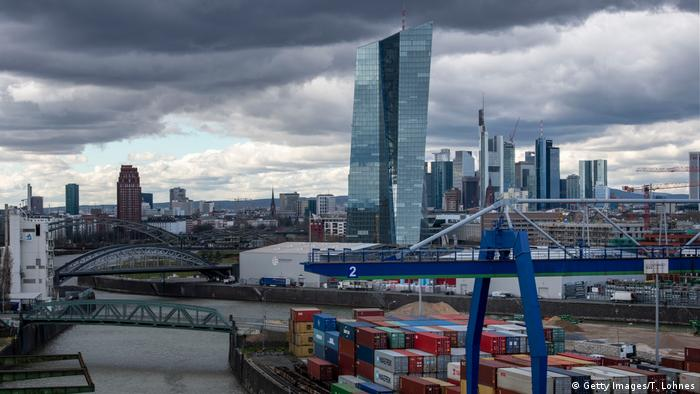 A pictor of the headquarters of the European Central Bank (ECB) in Frankfurt, Germany, in front of the city's skyline with the finance district, the river Main and the container harbor.