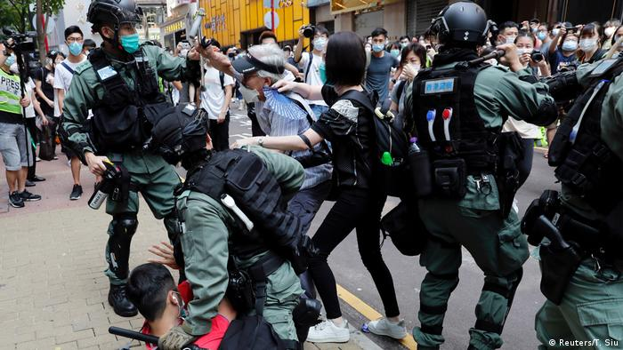 Police and protesters clash in the streets of Hong Kong