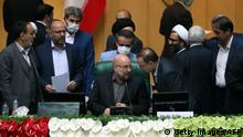 Iranian Mohamad Bagher Ghalibaf (C) sits among members of the parliament after being elected as parliament speaker at the Iranian parliament in Tehran on May 28, 2020. - Iran's newly formed parliament elected the former Tehran mayor Ghalibaf as its speaker, consolidating the power of conservatives ahead of next year's presidential election. State television said the 58-year-old received 230 votes out of the 267 cast to secure the post, one of the most influential positions in the Islamic republic. (Photo by STRINGER / AFP) (Photo by STRINGER/AFP via Getty Images)