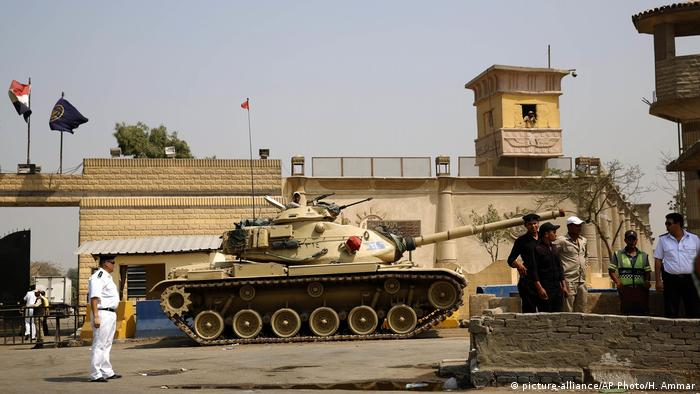 Egyptian security guards outside Tora prison in Cairo