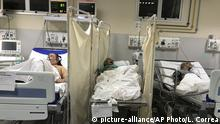 EDS NOTE: GRAPHIC CONTENT - A patient, who died from the new coronavirus, lies on a table between other COVID-19 patients in a room at the Salgado Filho Municipal Hospital in Rio de Janeiro, Brazil, early Sunday, May 24, 2020. (AP Photo/Leo Correa) |