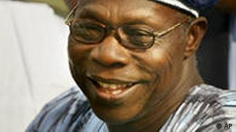 Re-elected President Olusegun Obasanjo smiles as he leaves a ceremony where he was presented with a certificate of return by the Independent National Electoral Commission at the INEC headquarters in the Nigerian capital Abuja Wednesday, April 23, 2003. (AP Photo/Ben Curtis)