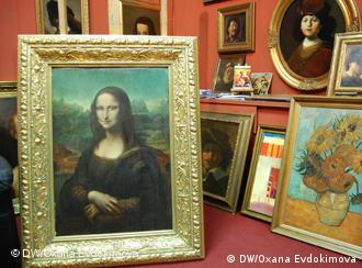 A copy of Mona Lisa and other famous paintings at the Posin Art Salon in Berlin