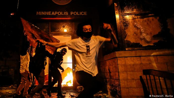 Protesters in Minneapolis set fire to the entrance of a police station following the death of George Floyd