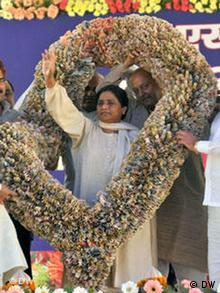 UP's Chief Minister Mayawati receiving a garland made of Indian Rupee banknotes