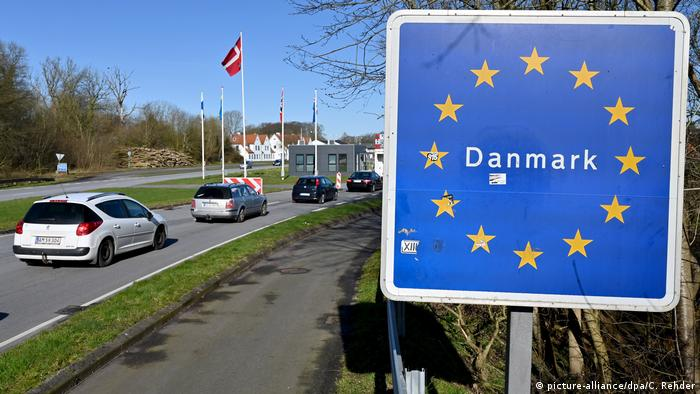 Signpost reading 'Danmark' at road with border-crossing