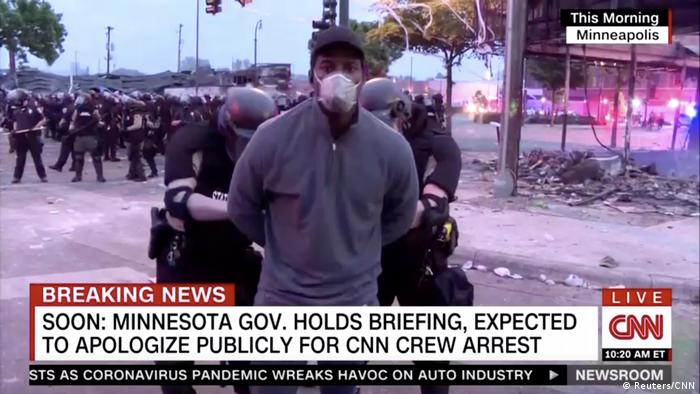 A screenshot of police arresting a member of a CNN crew broadcasting live while covering protests related to the death of of African-American man George Floyd