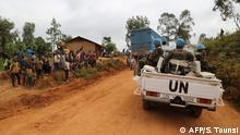 In this photograph taken on March 13, 2020, Moroccan soldiers from the UN mission in DRC (Monusco) ride in a vehicle as they patrol in the violence-torn Djugu territory, Ituri province, eastern DRCongo. - Fresh violences have been registered against civilians in this territory where more than 700 hundreds have been slaughtered since December 2017, leading the UN to denounce a possible crime against humanity. (Photo by SAMIR TOUNSI / AFP)