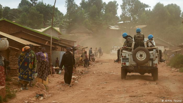 UN peacekeepers ride on a military vehicle in Ituri Province, DRC