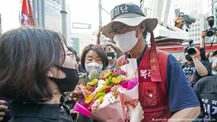Kim Yong-hee is given flowers