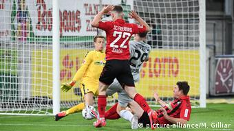 Havertz somehow manages to squeeze the ball past Schwolow