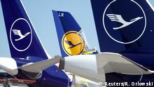 FILE PHOTO: Aircraft of the German carrier Lufthansa are parked on the tarmac, as the spread of the coronavirus disease (COVID-19) continues, at the airport in Frankfurt, Germany March 24, 2020. REUTERS/Ralph Orlowski/File Photo