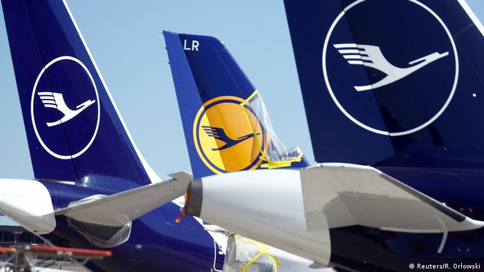 Aircraft of the German carrier Lufthansa are parked on the tarmac