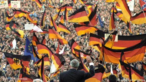 A crowd of people and German flags
