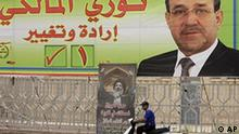 An election campaign poster for Iraqi Prime Minister Nouri al-Maliki, is seen in Baghdad, Iraq, Wednesday, March. 17, 2010. A secular coalition led by former Iraqi Prime Minister Ayad Allawi challenging the Iraqi prime minister in the country's historic parliamentary elections narrowly pulls ahead for the first time in the overall vote count. (AP Photo/Karim Kadim)
