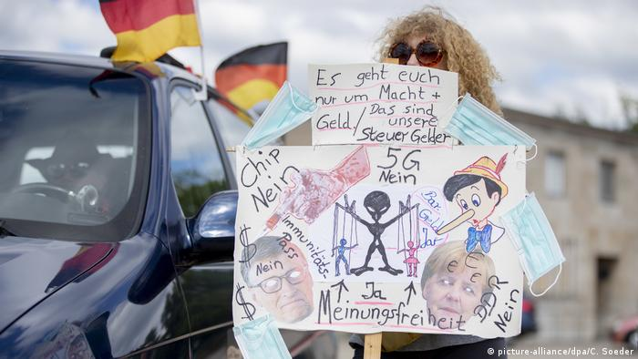 Celebrity Beauty: A protester waves a home made imprint in opposition to the coronavirus restrictions (describe-alliance/dpa/C. Soeder)