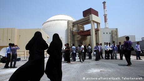 Iranian women security officials (foreground) and media at the opening of a nuclear plant in Bushehr, Iran in 2010