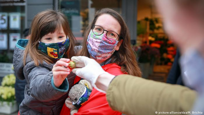 A German mother and daughter wearing masks