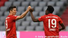 MUNICH, GERMANY - MAY 30: Alphonso Davies of Bayern Munich celebrates with Robert Lewandowski after scoring his team's fifth goal during the Bundesliga match between FC Bayern Muenchen and Fortuna Duesseldorf at Allianz Arena on May 30, 2020 in Munich, Germany. (Photo by Christof Stache/Pool via Getty Images)