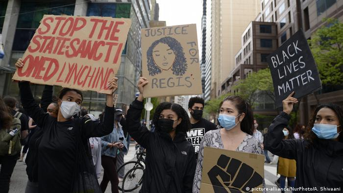 Protesters chanting Justice for Regis during a rally to protest the police involved deaths in North America
