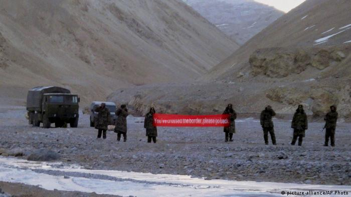 Chinese soldiers holding banner in Ladakh