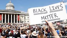 A person holds up a Black Live Matters sign during a protest against the death in Minneapolis police custody of African-American man George Floyd, in Trafalgar Square, London, Britain, May 31, 2020. REUTERS/John Sibley