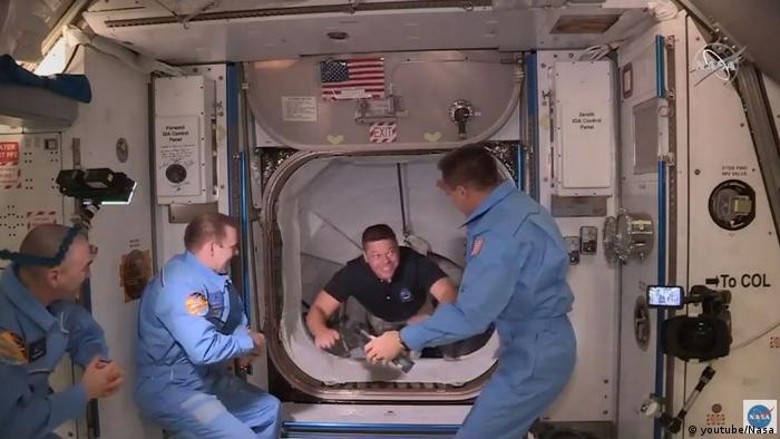 NASA astronauts enter the ISS