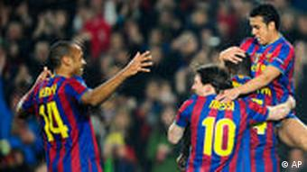 FC Barcelona's Pedro Rodriguez celebrates with his teammates after scoring against VfB Stuttgart during their round of 16 Champions League soccer match at the Camp Nou stadium in Barcelona, Spain, Wednesday, March 17 , 2010. (AP Photo/David Ramos)