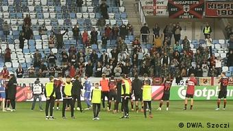 Honved players celebrating with their fans
