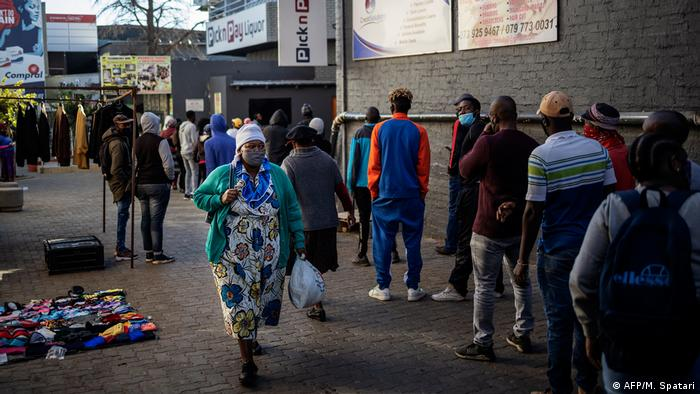 Customers queue outside a liquor shop in Soweto, Johannesburg (AFP/M. Spatari)