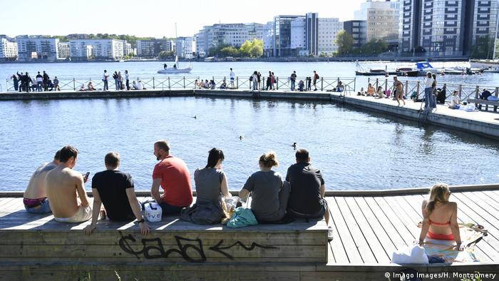 People enjoy warm weather in Stockholm during the coronavirus pandemic
