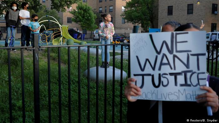 Children watch as protesters rally against the death in Minneapolis police custody of George Floyd