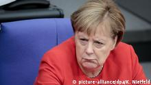 Angela Merkel looks critical