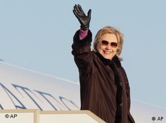 U.S. Secretary of State Hillary Rodham Clinton waves upon arrival in Moscow's Vnukovo airport on Thursday, March 18, 2010. Hillary Rodham Clinton is in Moscow to meet with senior Russian officials and to join top international diplomats in assessing the stalled Mideast peace process.(AP Photo/Ivan Sekretarev)