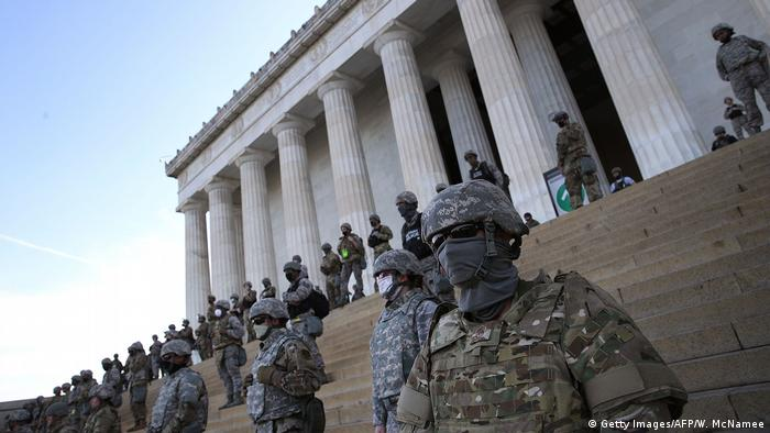 Members of the Washington DC National Guard stand on the steps of the Lincoln Memorial