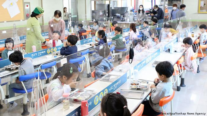 Transparent dividers installed at a primary school cafeteria in Chuncheon, South Korea. The Education Ministry said that 519 schools have been forced to go back to remote learning, as government guidelines direct that all students and staff members have to return to distance learning if an infection is confirmed.
