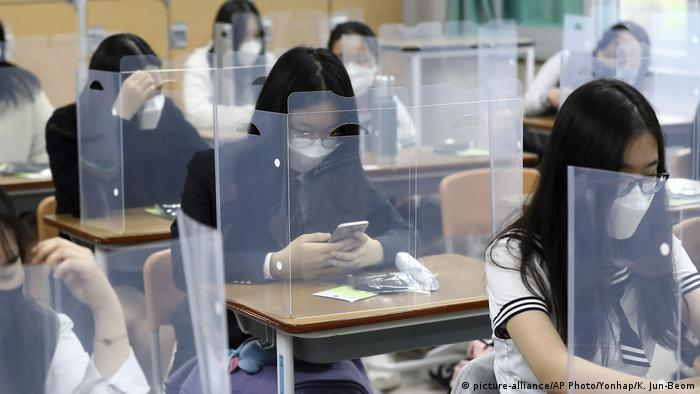 Guidelines mandate that desks are placed in a manner that allows for physical distancing. In many cases, schools are putting up partitions to prevent the spread of the virus. South Korea has seen a resurgence of cases linked to gatherings at night clubs, churches and warehouses in recent days. This has led to the imposition of stricter regulations.