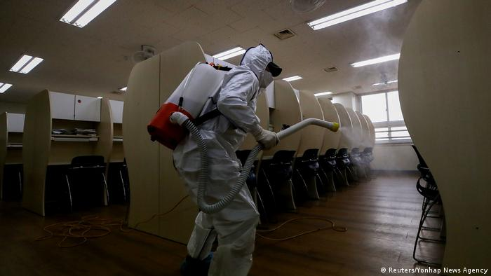 The image shows classrooms being disinfected by quarantine workers before students enter the premises of a school in Seoul. In the first phase of reopening, high school seniors returned to classes on May 20 for a session that was meant to begin in March this year.