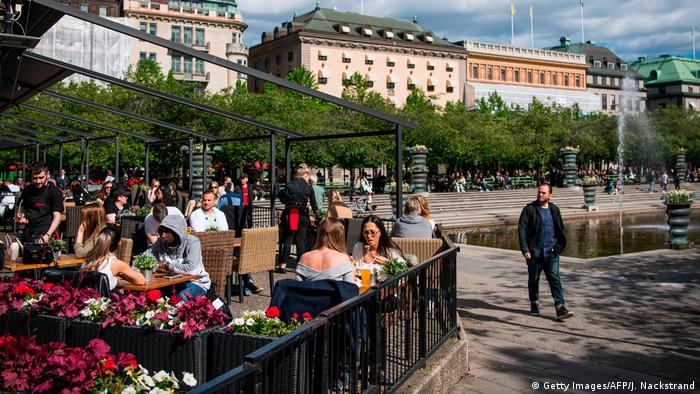 People sit at a restaurant terrace in Stockholm amid the coronavirus pandemic