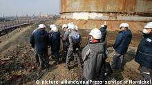 02.06.2020, Russland, Norilsk: 6255844 02.06.2020 In this handout photo released by the press-service of Nornickel, employees of Nornickel work at a site where, on May 29, diesel fuel has leaked out of a tank at the TPP-3 thermal power station, outside Norilsk, Russia. Russian authorities have declared a state of emergency after more than 20,000 tonnes of diesel fuel seeped into a Siberian river. Editorial use only, no archive, no commercial use. Press-service of Nornickel Foto: Press-service of Nornickel  
