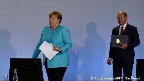 Ангела Меркель и министр финансов Олаф Шольц
