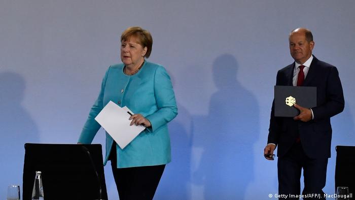 Almanya Başbakanı Angela Merkel ve Maliye Bakanı ve Başbakan Yardımcısı Olaf Scholz