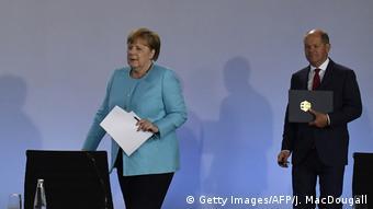 Канцлер Ангела Меркель и вице-канцлер, министр финансов Олаф Шольц на пресс-конференции 3 июня