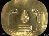 Золотая  маска из Museo del Oro в Боготе, где хранятся и золотые самолетики