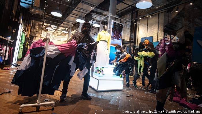 Protesters looting a Nike store in New York