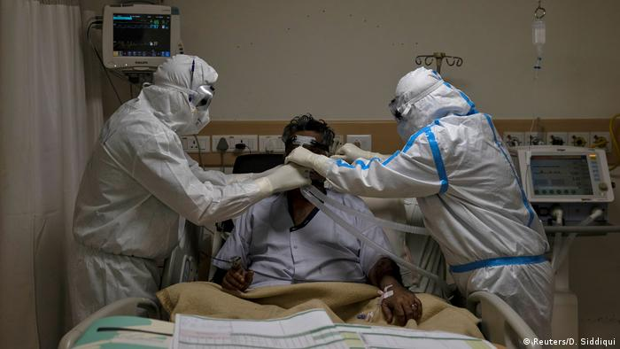 Medical workers wearing personal protective equipment (PPE) take care of a patient suffering from the coronavirus disease (COVID-19), at the Intensive Care Unit (ICU) of the Max Smart Super Speciality Hospital in New Delhi, India