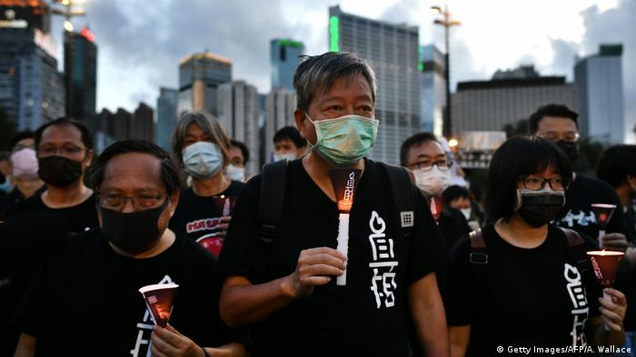 Hong Kong Alliance leader Lee Cheuk-yan leading a candlelight vigil for the victims of the Tiananmen Square massacre in Hong Kong in 2020